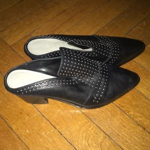 Black mule style shoes with small heel and studs